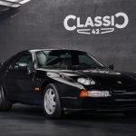 Photo d'une Porsche 928 GT noire de 1991 en vente chez CLASSIC 42 - Achat/Vente de voitures classiques allemandes www.classic42.be