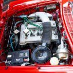 photo d'une Alfa Romeo Duetto rouge décapotable de 1966 en vente chez Classic 42 - Revendeur de voitures classiques Allemandes