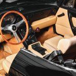 photo d'une Alfa Romeo Spider 2.0 noire décapotable de 1991 en vente chez Classic 42 - Revendeur de voitures classiques Allemandes
